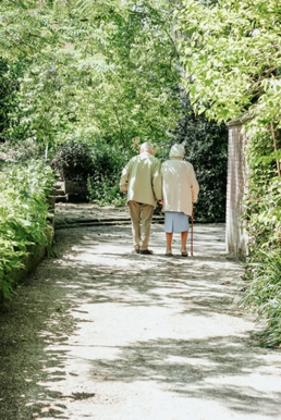 Elderly couple walking together